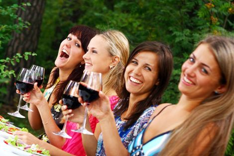 group of girls drinking wine
